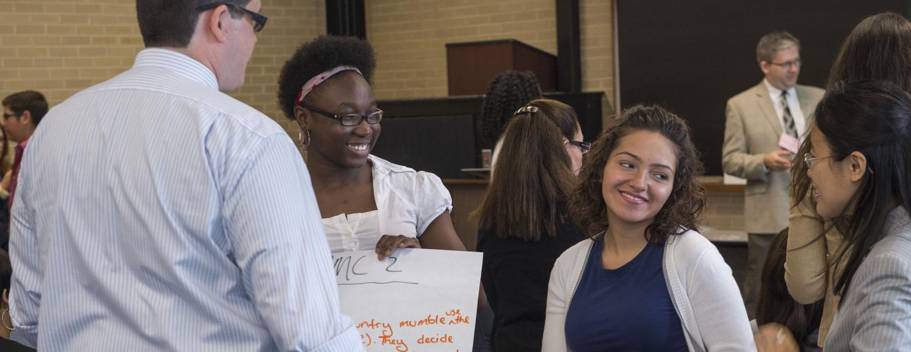 UTEP students talk to one another at an event